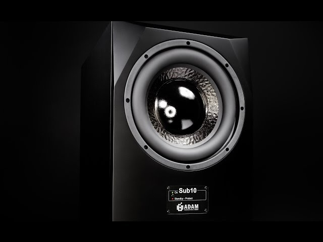 What is the benefit of using a subwoofer in a recording studio?
